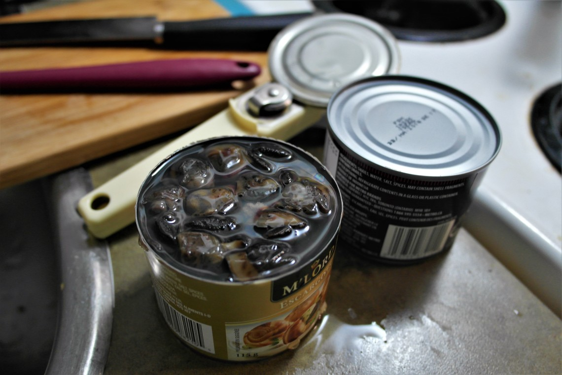 Opened escargot cans